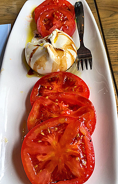 Somerset Pink Tomatoes with burrato, saba, and extra virgin olive oil